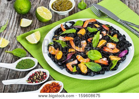 Black Noodles Salad With Prawns, Mussels, Fresh Green Herbs