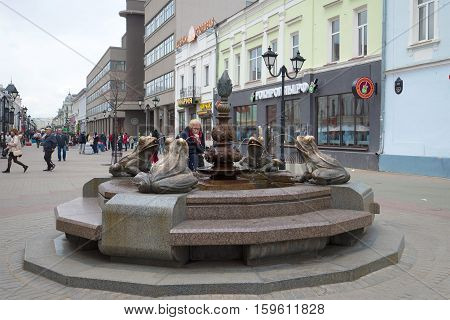 KAZAN, RUSSIA - APRIL 30, 2016: The fountain with frogs in the cloudy April afternoon. The tourist landmark of the city Kazan, Tatarstan