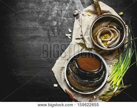 Fillet Of Pickled Herring With Spices In A Saucepan