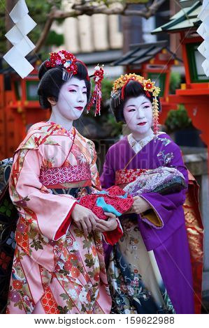 Kyoto, Japan - November 8, 2011: Two Maikos In Traditional Clothes Attending The Annual Kanikakni Fe