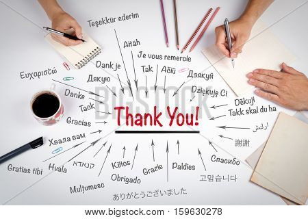 Thank You in different languages of the world. The meeting at the white office table.