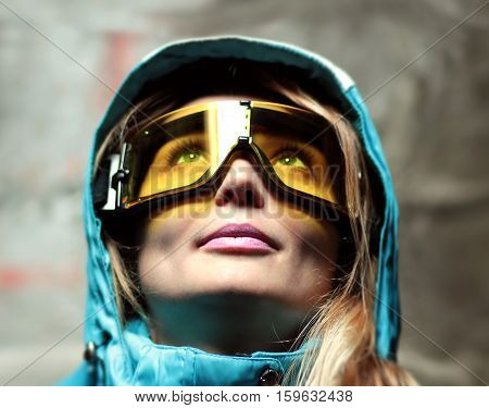 beautiful girl in snowboard mask and ski jacket