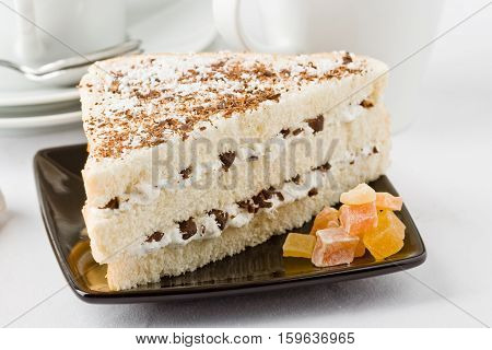 A delicious sweet sandwich of three layers with ricotta cheese and chocolate.