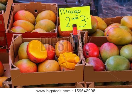 Fresh mangoes in cardboard boxes on the counter