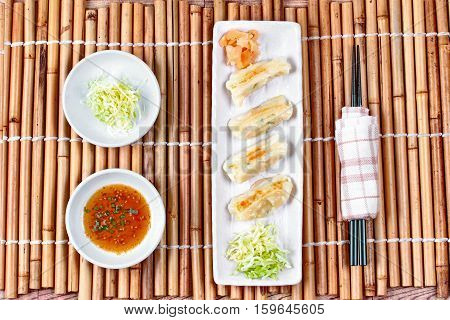 Japanese steamed stuffing flour with pork and cabbage as Gyoza with side disk.