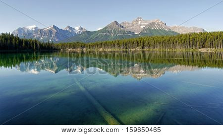 Mountains reflected in the lake. Canadian Rocky Mountains