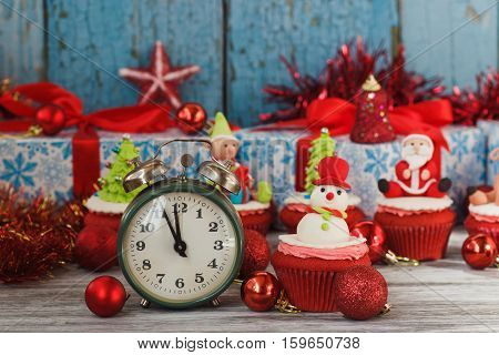 Christmas cupcakes with colored decorations Snowman made from confectionery mastic soft focus background