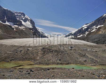 Glacial lake and creek. Canadian Rocky Mountains