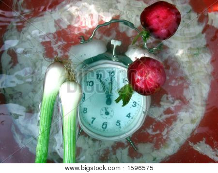 Table Clock And Vegetables