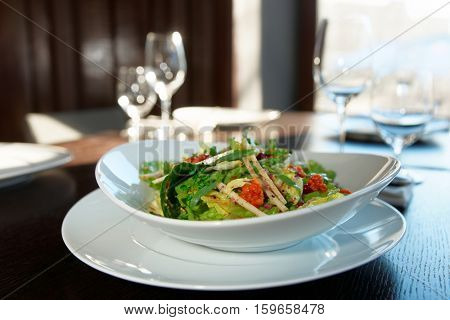 Green salad on arranged restaurant table