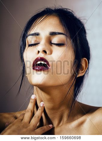beauty latin young woman in depression, hopelessness look, fashion makeup close up