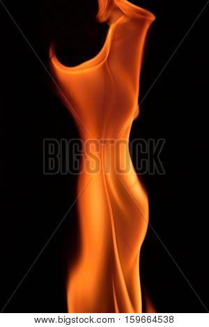 Flame fire on a black background. Silhouette of a woman. Flame.
