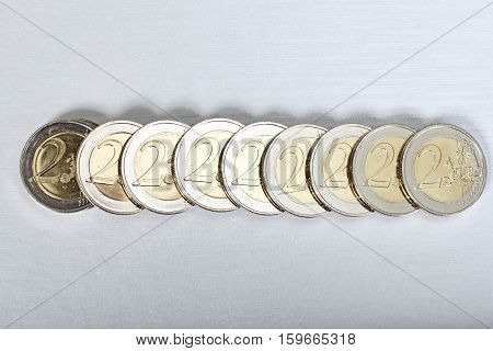 Euro coins close up view on white background.