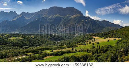 Summer afternoon view of the Devoluy Massif range with Faraut mountain and Pierroux Peak. Hautes Alpes Southern French Alps France