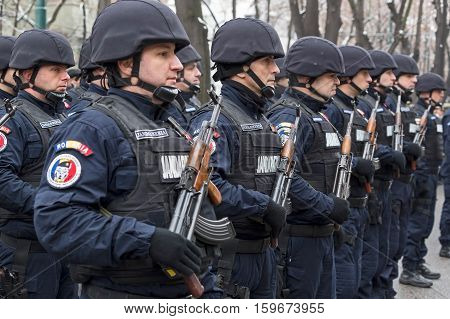 TIMISOARA ROMANIA - DECEMBER 1 2016: Military parade at Romanian National Day. Soldiers from gendarmerie in formation. Picture is taken in front of the Administrative Palace in Timisoara.