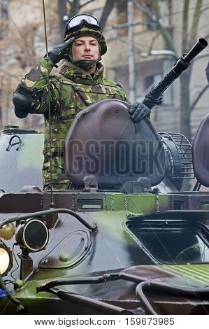 TIMISOARA ROMANIA - DECEMBER 1 2016: Military parade at Romanian National Day. Soldier in an armored car give a officially salute. Picture taken in front of the Administrative Palace in Timisoara.