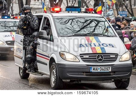 TIMISOARA ROMANIA - DECEMBER 1 2016: Military parade at Romanian National Day. Cops simulating a mission. Picture is taken in front of the Administrative Palace in Timisoara.