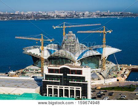 BAKU, AZERBAIJAN - OCT 4, 2016: Shopping center Caspian Waterfront Mall  in Baku on Oct 4, 2016, Azerbaijan Architectural form is inspired by the geometric shape of the Sydney Opera House.