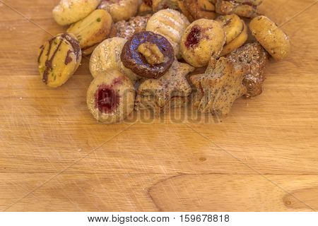 Several christmas cookies on rustic wooden plate