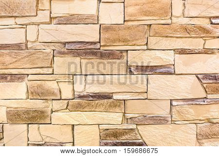 Weathered stoned wood background and alternative construction material - Blocks textured stonewall panel on modern fashion design - Retro old fashioned backdrop pattern