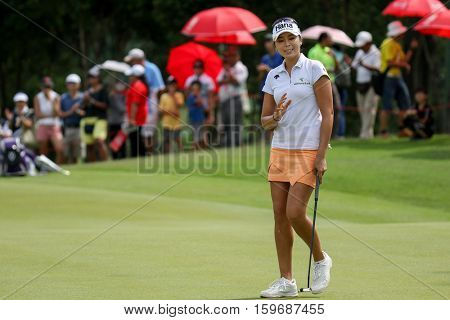 KUALA LUMPUR, MALAYSIA - OCTOBER 29, 2016: Mi Jung Hur of South Korea reacts after a birdie shot at the TPC Golf Course at the 2016 Sime Darby LPGA Malaysia golf tournament.