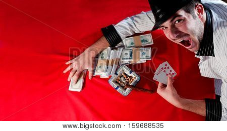 Happy gambler with Royal flush and money