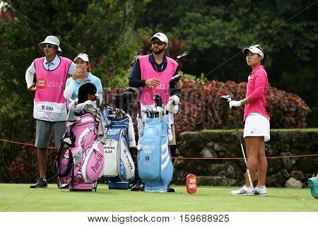 KUALA LUMPUR, MALAYSIA - OCTOBER 29, 2016: LPGA golfers and their caddies wait to tee off at the TPC Golf Course at the 2016 Sime Darby LPGA Malaysia golf tournament.