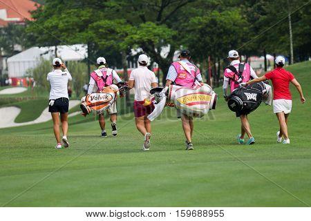 KUALA LUMPUR, MALAYSIA - OCTOBER 29, 2016: LPGA golfers walk towards the green from the fairway at the TPC Golf Course at the 2016 Sime Darby LPGA Malaysia golf tournament.