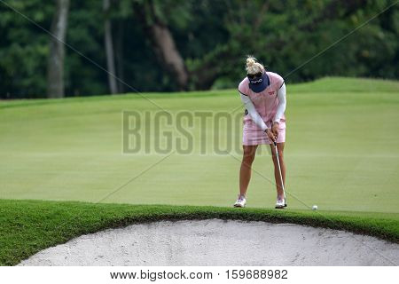 KUALA LUMPUR, MALAYSIA - OCTOBER 29, 2016: Pernila Lindberg of Sweden putts on the green at the TPC Golf Course at the 2016 Sime Darby LPGA Malaysia golf tournament.