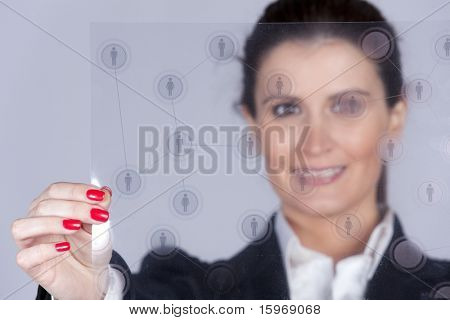 Businesswoman holding a social network schema (selective and shallow DOF)