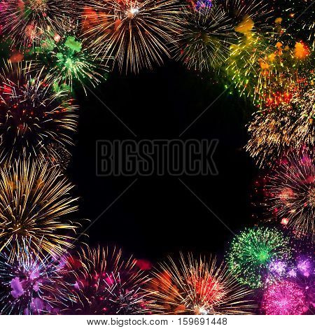 Greeting card with various colorful fireworks on black background. Multicolored Frame. Web banner. Can be used to design of holidays: Christmas New year anniversary independence day Birthday
