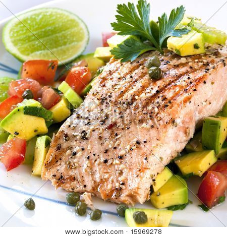 Grilled Atlantic salmon with an avocado and tomato salsa.  Delicious healthy eating.