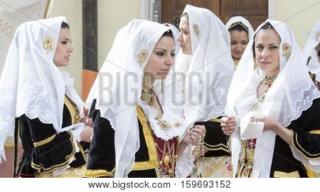 CAGLIARI, ITALY - May 1, 2014: 358 Religious Procession of Sant'Efisio - Sardinia - group of girls in traditional Sardinian costumes