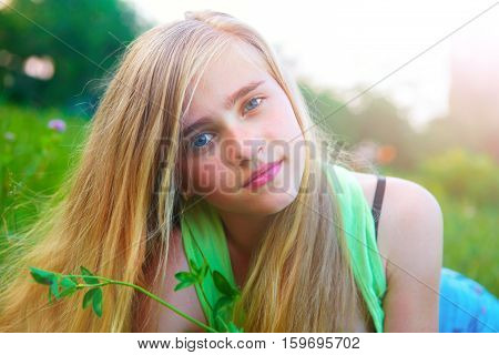 Young Girl In The Garden In The Morning
