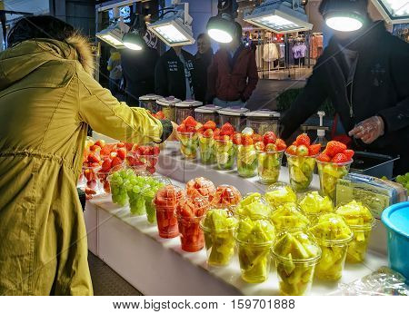 Fruit Buying At Myeongdong Open Street Market In Seoul
