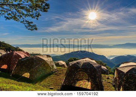 View of morning mist and sun rise at Doi Ang Khang mountain one of the famous mountains in Chiangmaiplace for camping with tent on winter Chiang Mai Thailand.