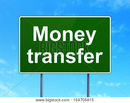 Currency concept: Money Transfer on green road highway sign, clear blue sky background, 3D rendering