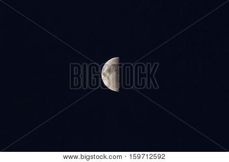 half of the moon to us a dark night sky background