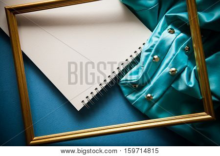 elegant vintage background with notebook in blue shades