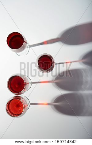 Red wine glass with stem isoalted on white background view from top