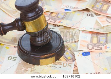 Wooden Law Gavel and Euro Money bills close up