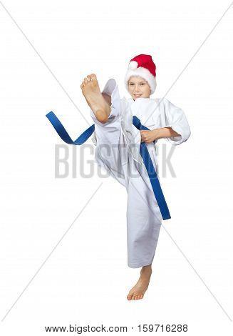 Blow leg forward beats athlete in the cap of Santa Claus