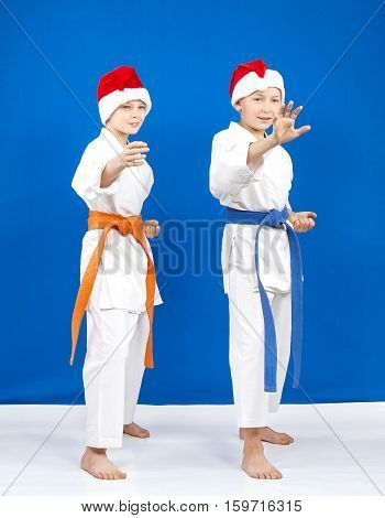 In rack of karate are athletes in the cap of Santa Claus