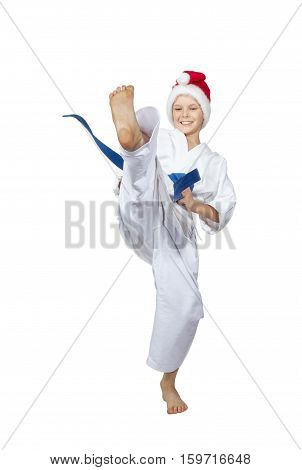 Sportsman with a blue belt and in cap of Santa Claus