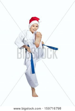 Cheerful athlete beats kicking on a white background