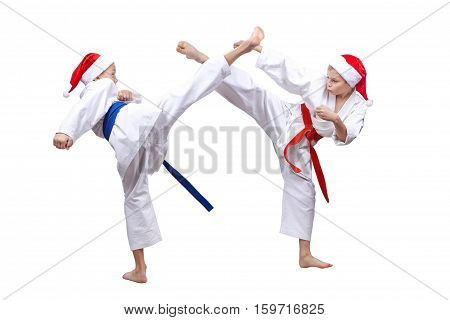 On white background boys are beating kick to meet each other