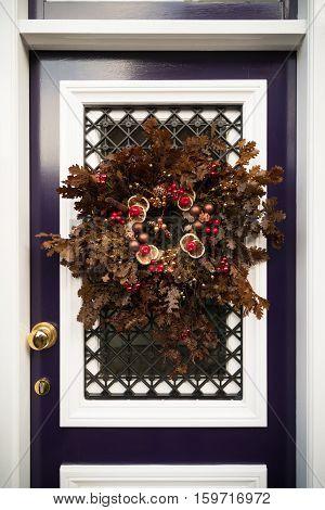 decorative christmas wreath on a white door