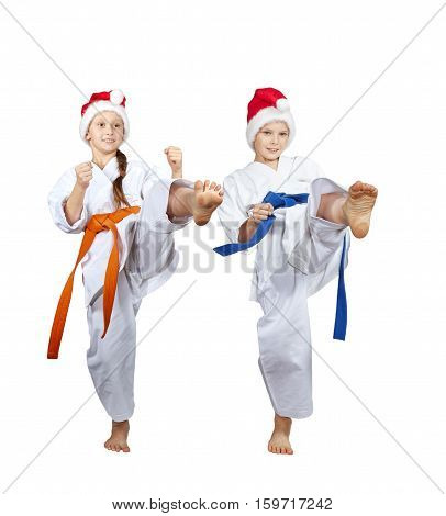 Boy and girl athletes are beating kick leg forward