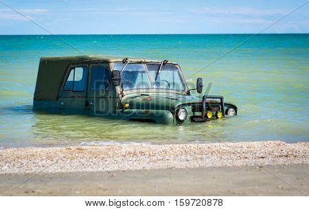 car submerged in the sea water day