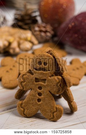 Christmas smiling gingerbread men men and women on rustic wooden background